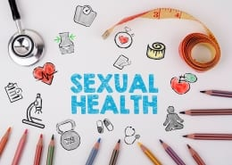 Sexual Health concept. On the table stethoscope and colored pencils